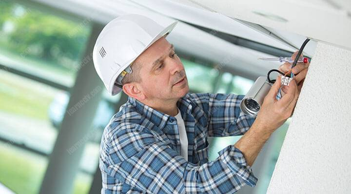 man installing a security camera system