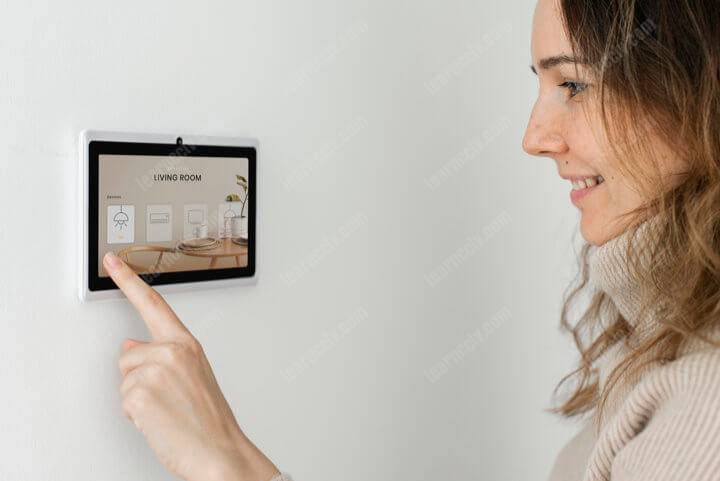 Woman pressing alarm panel buttons