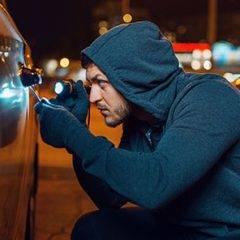 Car thief at night